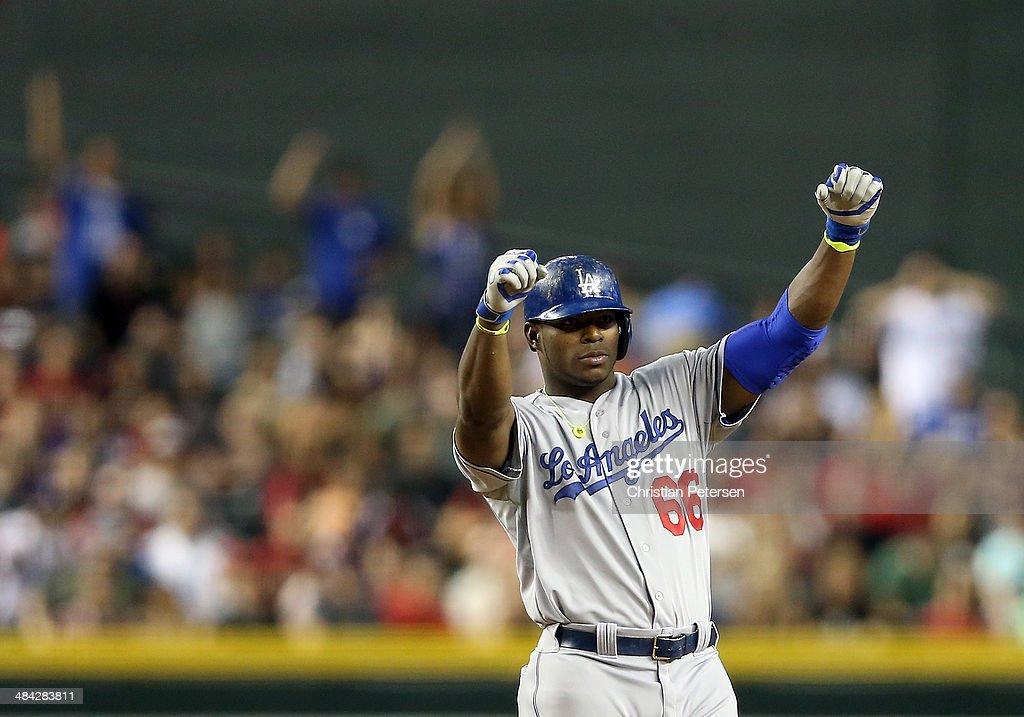 Yasiel Puig #66 of the Los Angeles Dodgers reacts at second base after hitting a double against the Arizona Diamondbacks during the eighth inning of the MLB game at Chase Field on April 11, 2014 in Phoenix, Arizona. The Dodgers defeated the Diamondbacks 6-0.