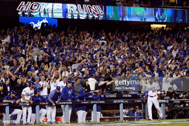 Yasiel Puig of the Los Angeles Dodgers reacts to a Joc Pederson solo home run in the seventh inning during Game 6 of the 2017 World Series against...
