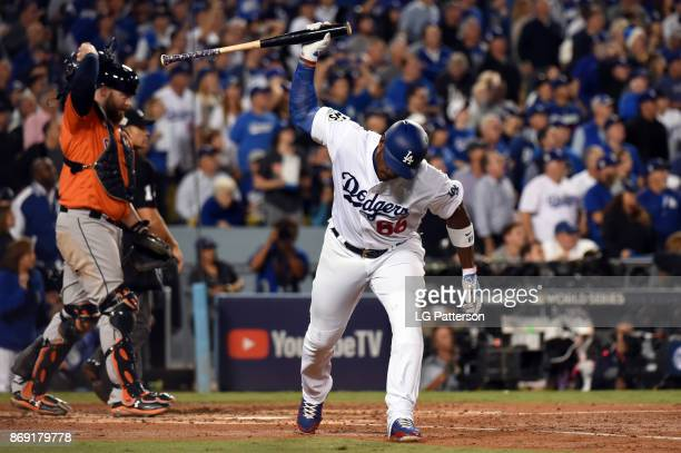 Yasiel Puig of the Los Angeles Dodgers reacts to flying out in the third inning during Game 7 of the 2017 World Series against the Houston Astros at...