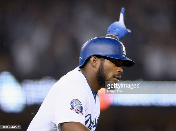 Yasiel Puig of the Los Angeles Dodgers reacts to his three run homerun to take a 52 lead over the Colorado Rockies during the seventh inning at...