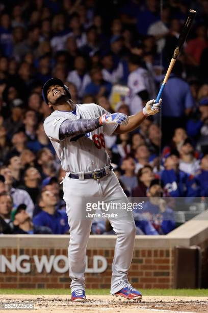 Yasiel Puig of the Los Angeles Dodgers reacts to popping out in the third inning against the Chicago Cubs during game four of the National League...