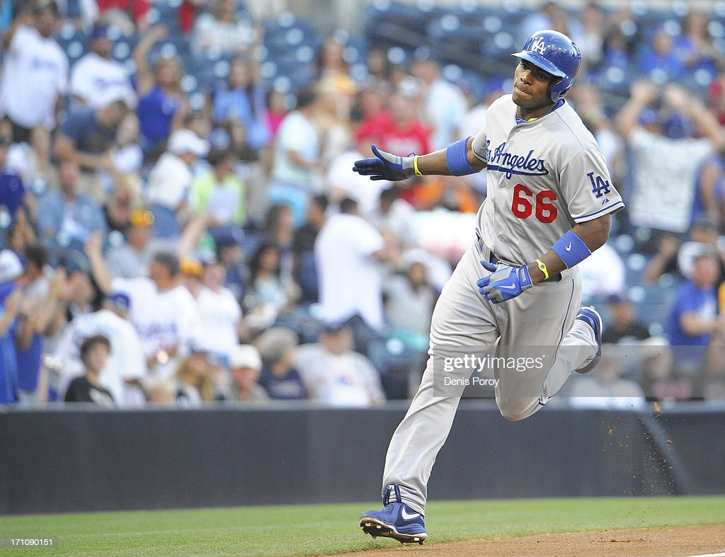 Yasiel Puig #66 of the Los Angeles Dodgers rounds the bases after hitting a solo home run during the first inning of a baseball game against the San Diego Padres at Petco Park on June 20, 2013 in San Diego, California.