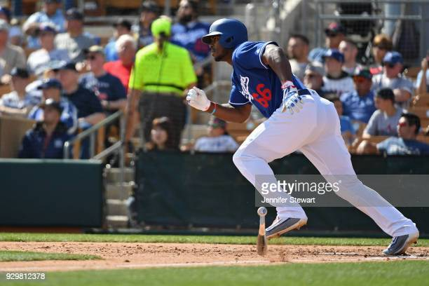 Yasiel Puig of the Los Angeles Dodgers runs to first base in the spring training game against the Cleveland Indians at Camelback Ranch on March 1...