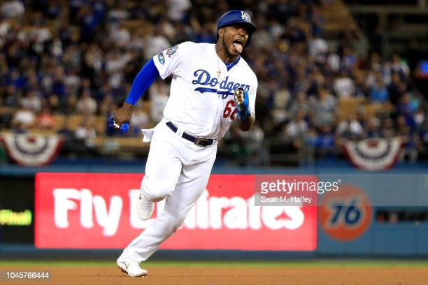 Yasiel Puig of the Los Angeles Dodgers runs to third base during the eighth inning against the Atlanta Braves during Game One of the National League...