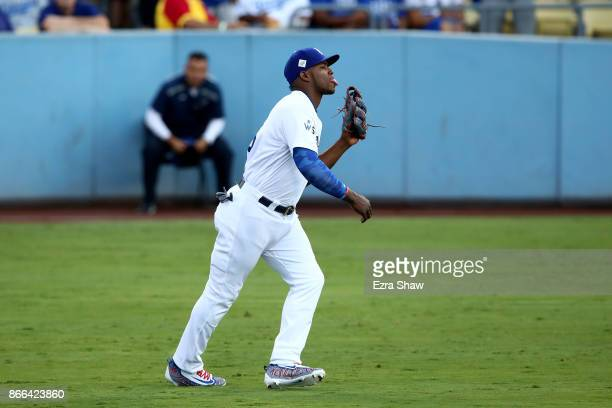 Yasiel Puig of the Los Angeles Dodgers sticks his tongue out in the outfield during the first inning against the Houston Astros in game two of the...