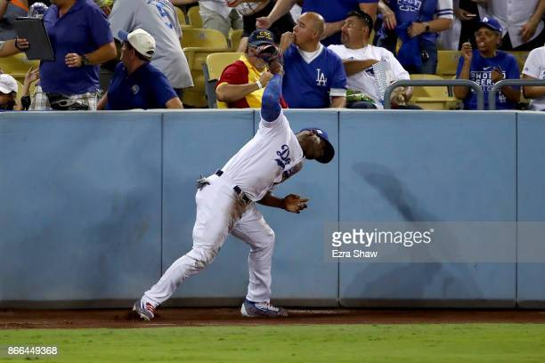 Yasiel Puig of the Los Angeles Dodgers throws his glove after he was unable to catch a ground rule double hit by Alex Bregman of the Houston Astros...
