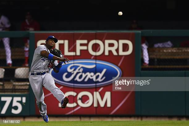Yasiel Puig of the Los Angeles Dodgers turns a double play on a ball hit by David Freese of the St. Louis Cardinals in the seventh inning of Game One...