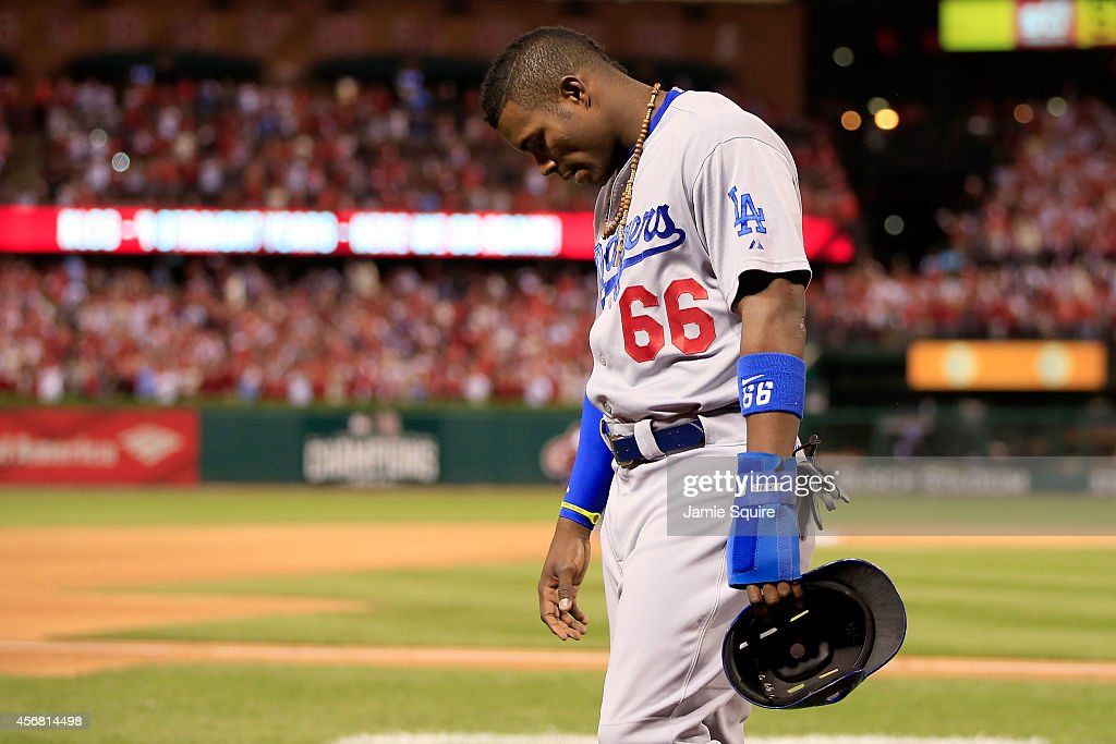 Yasiel Puig #66 of the Los Angeles Dodgers walks off the field after being defeated by the St. Louis Cardinals in Game Four of the National League Divison Series at Busch Stadium on October 7, 2014 in St Louis, Missouri.