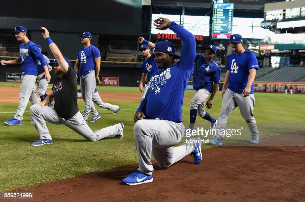 Yasiel Puig of the Los Angeles Dodgers warms up before the National League Divisional Series game three against the Arizona Diamondbacks at Chase...