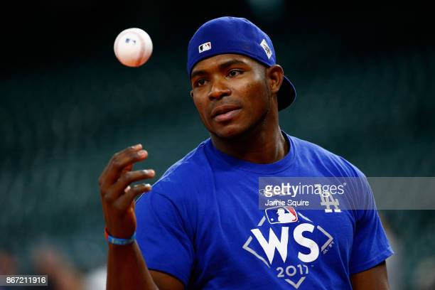Yasiel Puig of the Los Angeles Dodgers warms up during batting practice before game three of the 2017 World Series against the Houston Astros at...