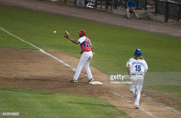 Yasiel Santoya of the Cuban National Team receives throw for a force out as Jared Schlehuber of the Rockland Boulders runs to first base during the...