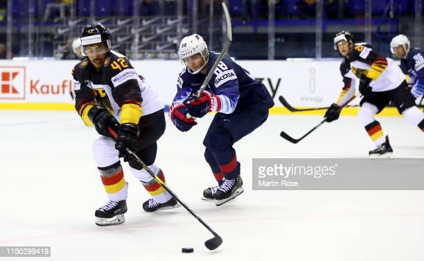Yasin Ehliz of Germany challenges Patrick Kane of United States during the 2019 IIHF Ice Hockey World Championship Slovakia group A game between...
