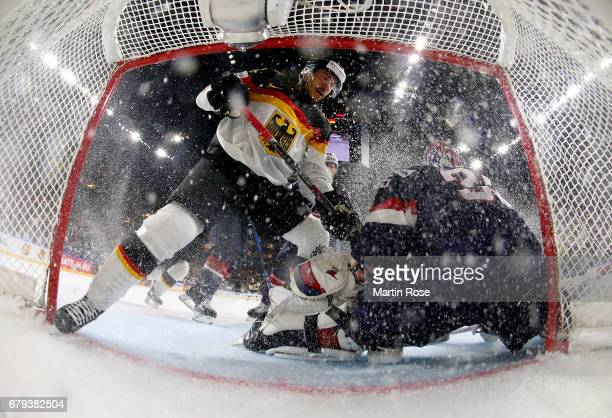 Yasin Ehliz of Germany slids into the net during the 2017 IIHF Ice Hockey World Championship game between USA and Germany at Lanxess Arena on May 5,...