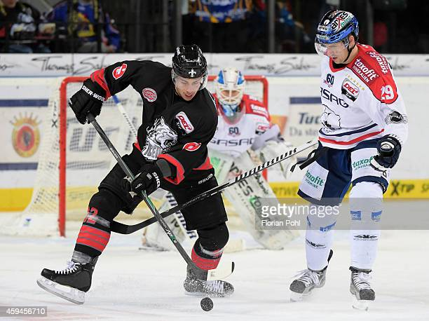 Yasin Ehliz of the Thomas Sabo Ice Tigers Nuernberg and Jens Baxmann of the Eisbaeren Berlin duel during the game between Thomas Sabo Ice Tigers and...