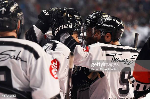 Yasin Ehliz of Thomas Sabo Ice Tigers celebrates with team mates as he scores the opening goal during the DEL Ice Hockey Playoffs Quarter Final Game...