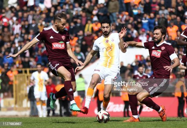 Yasin Gureler and Soner Ornek of Hatayspor in action against Emre Akbaba of Galatasaray during the Ziraat Turkish Cup quarter final return match...