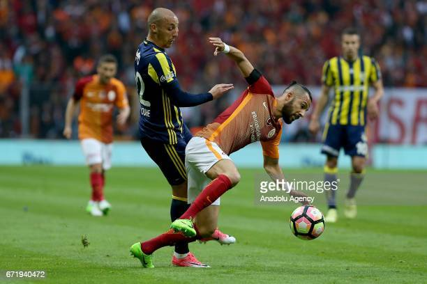 Yasin Oztekin of Galatasaray in action against Aatif Chahechouhe of Fenerbahce during the Turkish Spor Toto Super Lig football match between...