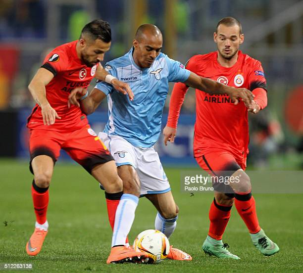 Yasin Oztekin with Wesley Snijder of Galatasaray competes for the ball with Abdoulay Konko of SS Lazio during the UEFA Europa League Round of 32...