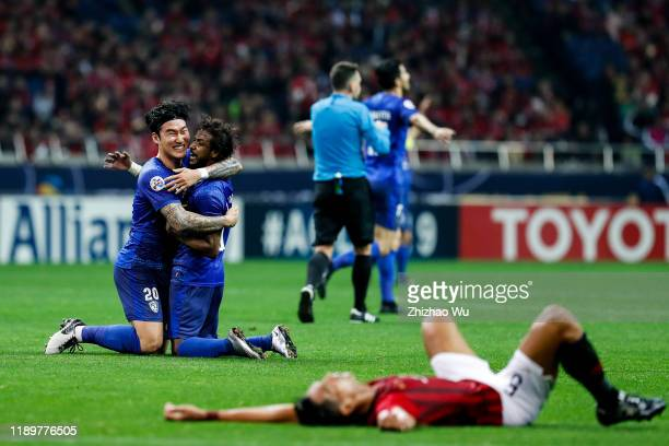 Yasir Gharsan Alshahrani and Jang Hyun Soo of Al Hilal celebrate the victory after the AFC Champions League Final second leg match between Urawa Red...