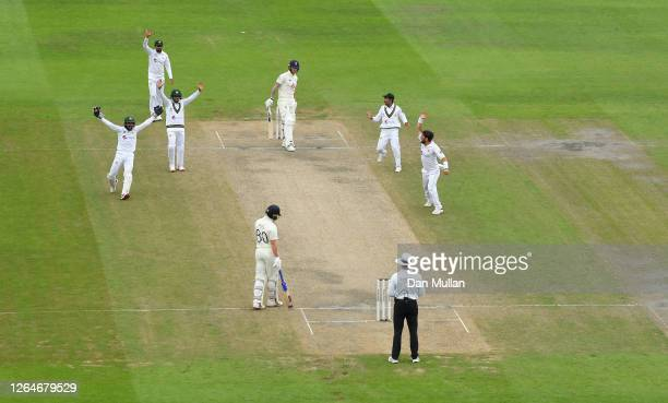 Yasir Shah and teammates appeal successfully for the wicket of Ben Stokes of England during Day Four of the 1st #RaiseTheBat Test Match between...
