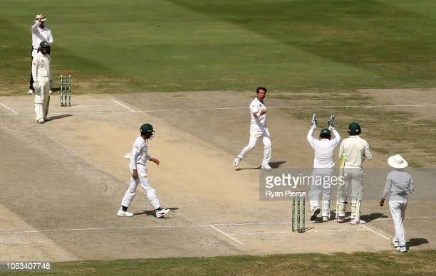 Yasir Shah of Pakistan celebrates after taking the wicket of Marnus Labuschagne of Australia during day five of the First Test match in the series...