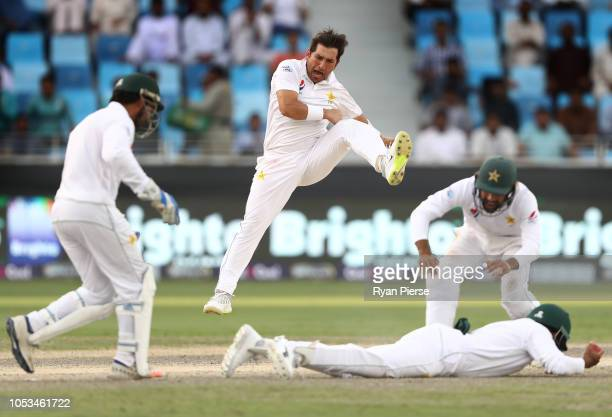 Yasir Shah of Pakistan celebrates after taking the wicket of Mitchell Starc of Australia caught by Babar Azam of Pakistan during day five of the...