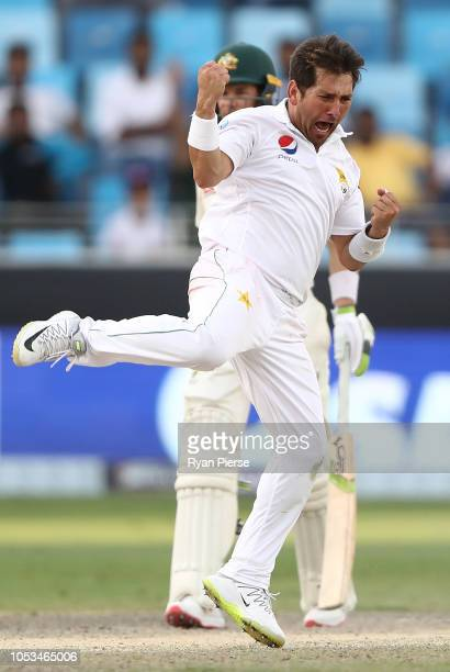 Yasir Shah of Pakistan celebrates after taking the wicket of Peter Siddle of Australia during day five of the First Test match in the series between...