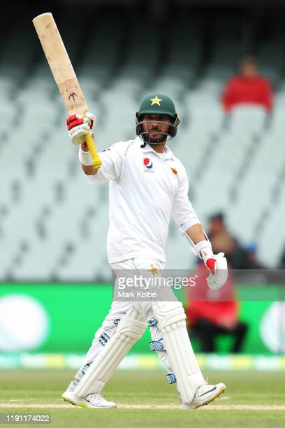 Yasir Shah of Pakistan celebrates his half century during day three of the 2nd Domain Test between Australia and Pakistan at the Adelaide Oval on...