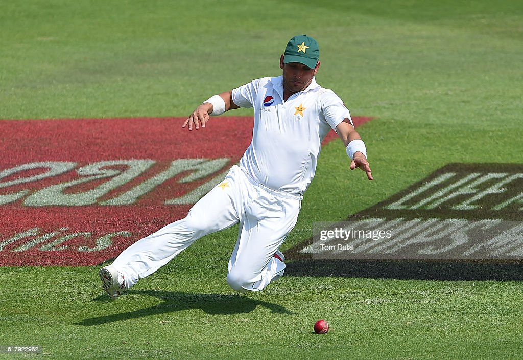 Yasir Shah of Pakistan chases the ball during Day Five of the Second Test between Pakistan and West Indies at Zayed Cricket Stadium on October 25, 2016 in Abu Dhabi, United Arab Emirates.