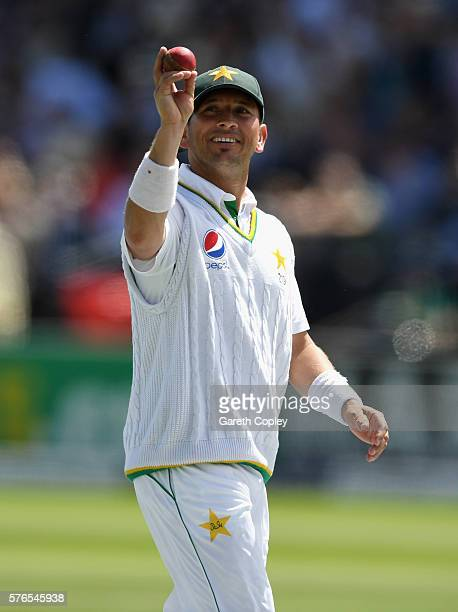 Yasir Shah of Pakistan holds up the ball as he leaves the field after picking a six wicket haul during day three of the 1st Investec Test between...