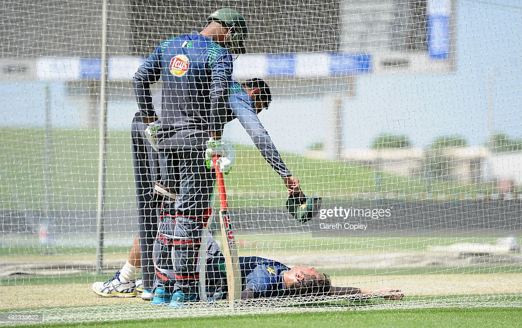 Yasir Shah of Pakistan lies on the ground after picking up an injury during a nets session at Zayed Cricket Stadium on October 12, 2015 in Abu Dhabi, United Arab Emirates.