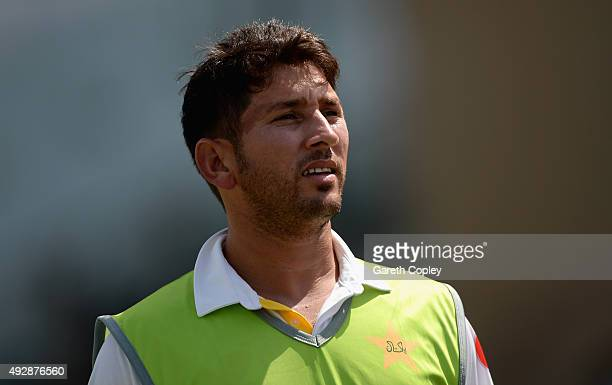 Yasir Shah of Pakistan watches from the oundary edge during day four of the 1st Test between Pakistan and England at Zayed Cricket Stadium on October...