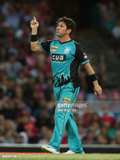 Yasir Shah of the Heat celebrates taking the wicket of Daniel Hughes of the Sixers during the Big Bash League match between the Sydney Sixers and the...