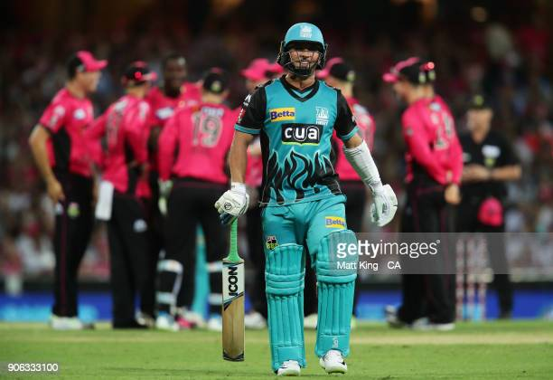Yasir Shah of the Heat walks from the field after being dismissed Carlos Brathwaite of the Sixers during the Big Bash League match between the Sydney...