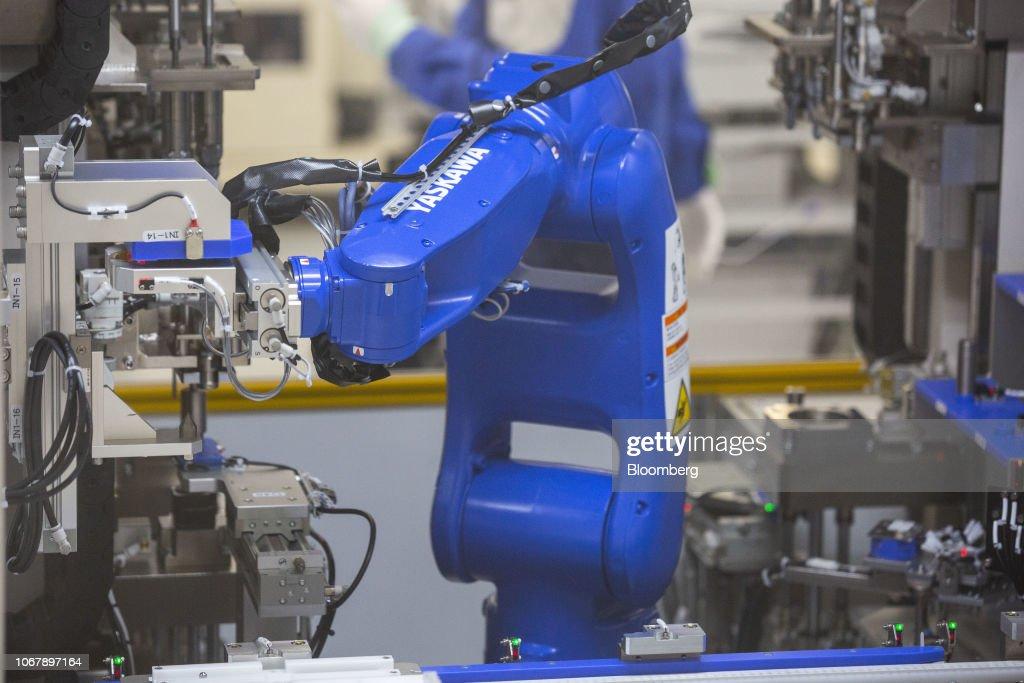 A Yaskawa Electric Corp  Motoman robot operates on the