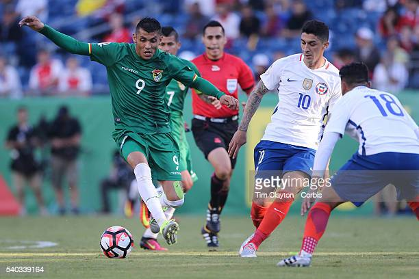 Yasmani Duk of Bolivia and Pablo Hernandez of Chile in action during the Chile Vs Bolivia Group D match of the Copa America Centenario USA 2016...