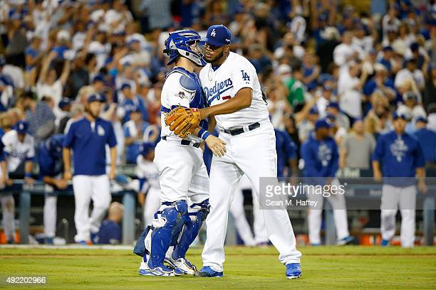 Yasmani Grandal and Kenley Jansen of the Los Angeles Dodgers celebrate after the Dodgers 52 victory against the New York Mets in game two of the...