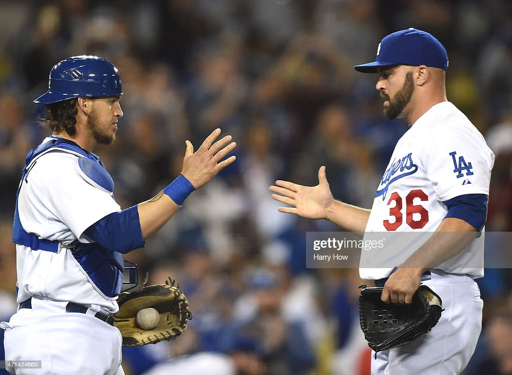 Yasmani Grandal #9 of the Los Angeles Dodgers and Adam Liberatore #36 celebrate a 7-3 win over the Colorado Rockies at Dodger Stadium on April 17, 2015 in Los Angeles, California.