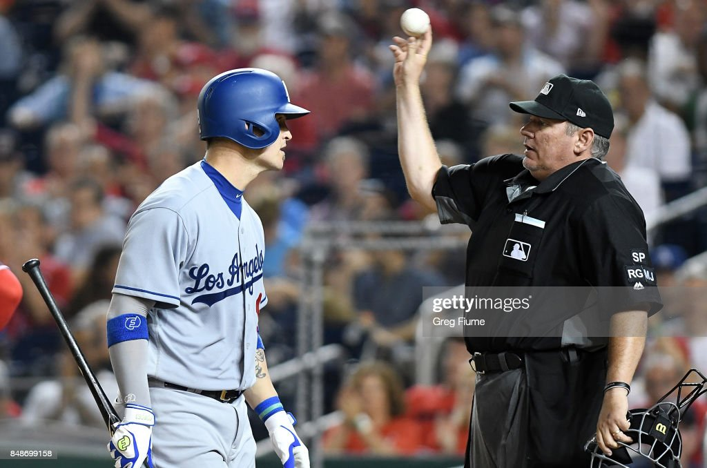 Yasmani Grandal #9 of the Los Angeles Dodgers argues with home plate umpire Hunter Wendelstedt #21 after being called out on strikes in the sixth inning against the Washington Nationals at Nationals Park on September 17, 2017 in Washington, DC.