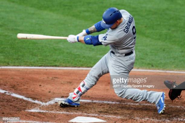 Yasmani Grandal of the Los Angeles Dodgers bats during a MLB game against the Cleveland Indians at Progressive Field on June 13 2017 in Cleveland Ohio