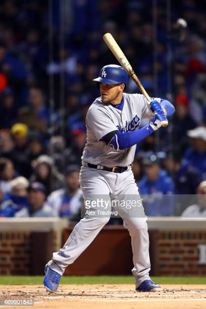 Yasmani Grandal of the Los Angeles Dodgers bats during the game against the Chicago Cubs at Wrigley Field on Wednesday April 12 2017 in Chicago...