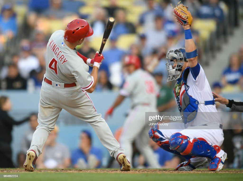 Yasmani Grandal #9 of the Los Angeles Dodgers catches a high inside fastball that nearly hit Scott Kingery #4 of the Philadelphia Phillies in the seventh inning at Dodger Stadium on May 31, 2018 in Los Angeles, California.