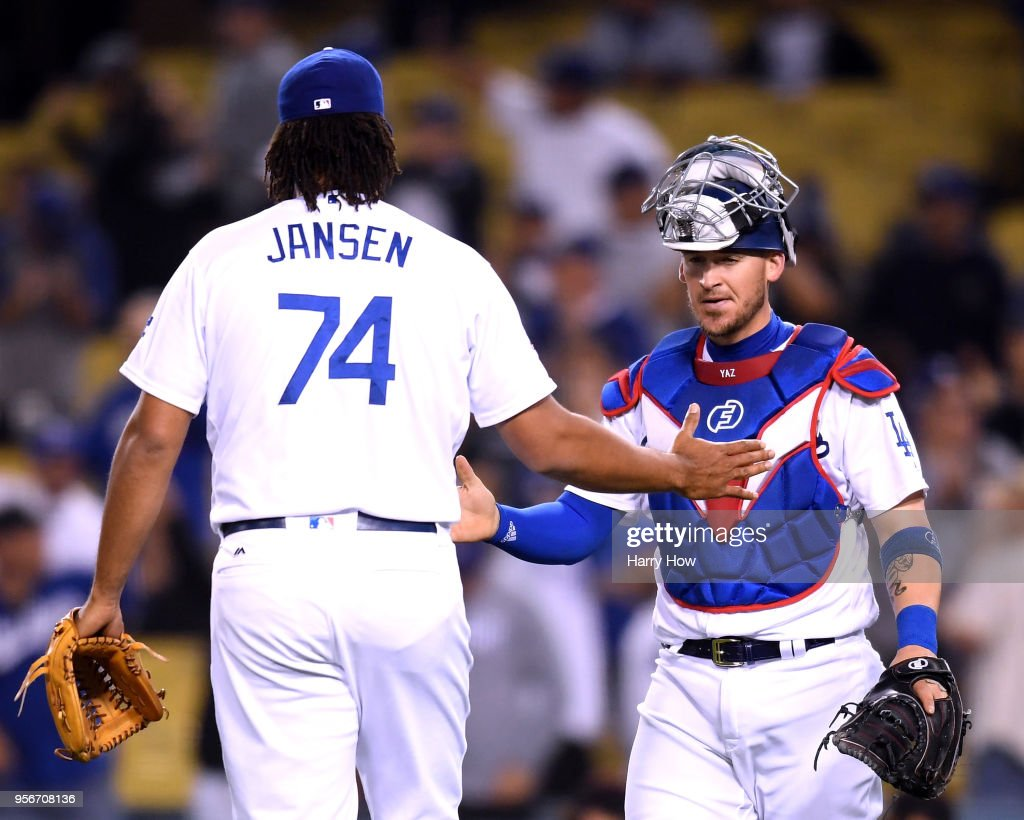 Yasmani Grandal #9 of the Los Angeles Dodgers celebrates a Kenley Jansen #74 save and a 6-3 win over the Arizona Diamondbacks at Dodger Stadium on May 9, 2018 in Los Angeles, California.