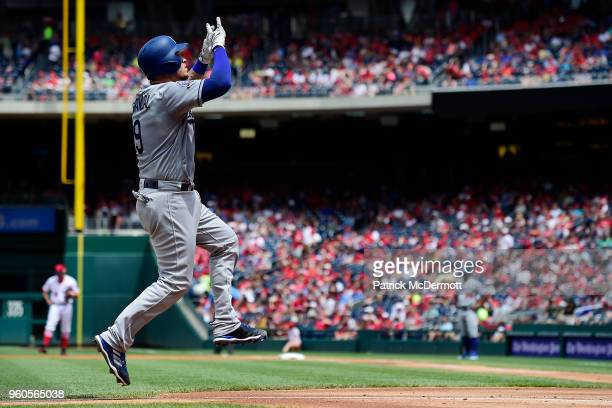 Yasmani Grandal of the Los Angeles Dodgers celebrates after hitting a solo home run in the second inning against the Washington Nationals at...