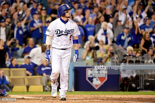 Yasmani Grandal of the Los Angeles Dodgers celebrates as he hits a tworun home run in the fourth inning against the Chicago Cubs in game three of the...