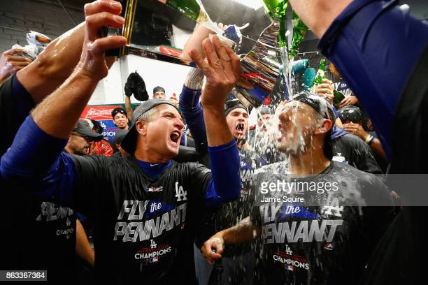 Yasmani Grandal of the Los Angeles Dodgers celebrates in the clubhouse after defeating the Chicago Cubs 111 in game five of the National League...