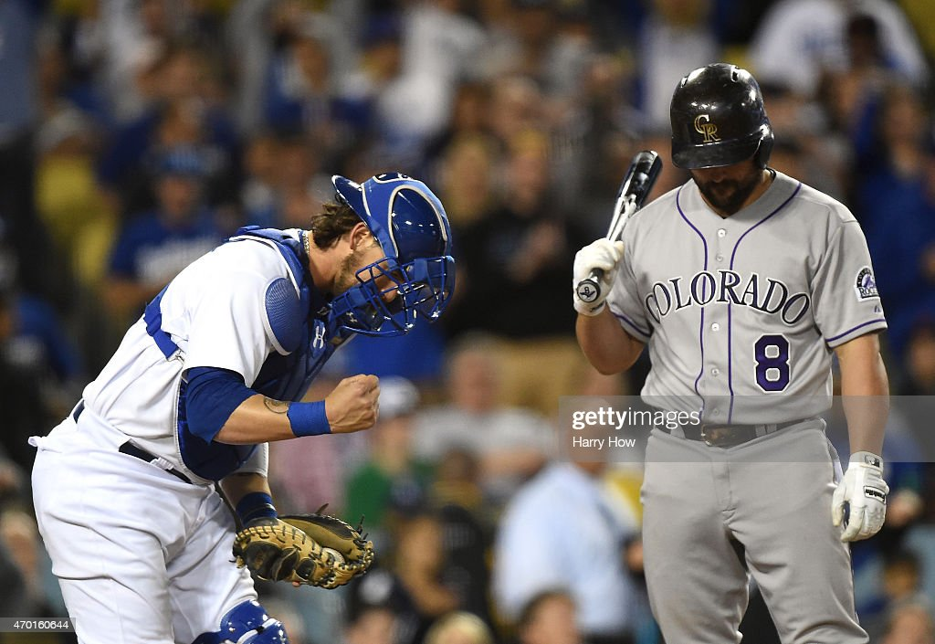 Yasmani Grandal #9 of the Los Angeles Dodgers celebrates the strikeout of Michael McKenry #8 of the Colorado Rockies to end the game and a 7-3 win at Dodger Stadium on April 17, 2015 in Los Angeles, California.