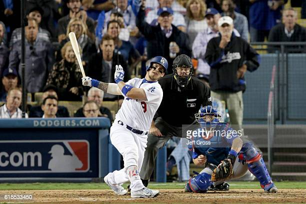 Yasmani Grandal of the Los Angeles Dodgers hits a tworun home run in the fourth inning against the Chicago Cubs in game three of the National League...
