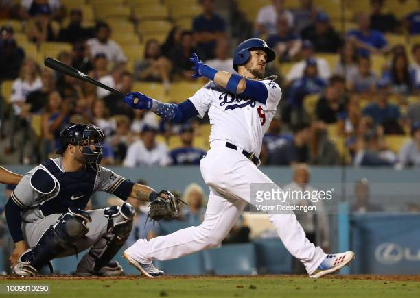 Yasmani Grandal of the Los Angeles Dodgers hits a walkoff homerun in the tenth inning of the MLB game against the Milwaukee Brewers at Dodger Stadium...