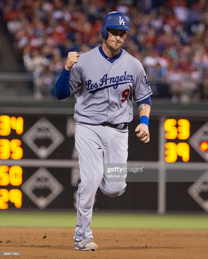 Yasmani Grandal #9 of the Los Angeles Dodgers reacts after Howie Kendrick #47 hit a two run home run in the top of the fifth inning against the Philadelphia Phillies at Citizens Bank Park on August 16, 2016 in Philadelphia, Pennsylvania. The Dodgers defeated the Phillies 15-5.